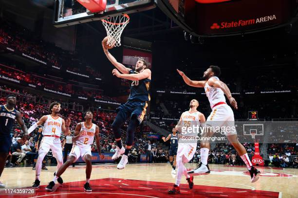 Nicolo Melli of the New Orleans Pelicans shoots the ball against the Atlanta Hawks during a preseason game on October 7 2019 at State Farm Arena in...