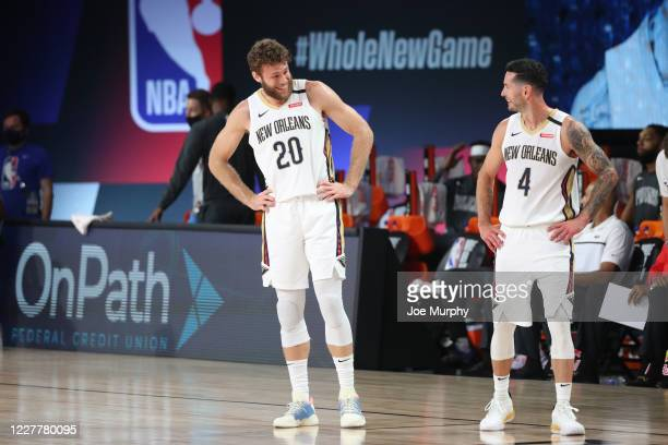 Nicolo Melli shares a laugh with JJ Redick of the New Orleans Pelicans during the game on July 25 2020 at HP Field House at ESPN Wide World of Sports...