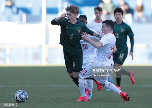 Nicolo Rovella of Italy is challenged by Fabio Solimando of Switzerland during the International Friendly match between Italy U19 and Switzerland U19...