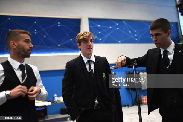Nicolo Zaniolo Leonardo Spinazzola and Gianluca Mancini look on ahead of the Italy team photo with the new Armani suit at Centro Tecnico Federale di...