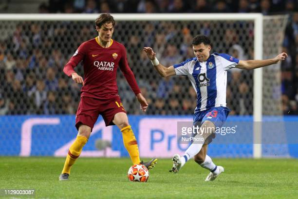 Nicolo Zaniolo midfielder of AS Roma vies with Porto's Portuguese defender Pepe during the UEFA Champions League match between FC Porto and AS Roma...