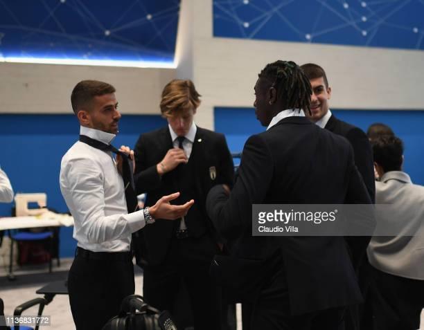 Nicolo Zaniolo Moise Kean Leonardo Spinazzola and Gianluca Mancini discuss ahead of Italy team photo with the new Armani suit at Centro Tecnico...