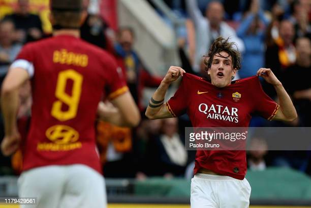 Nicolo' Zaniolo of AS Roma celebrates after scoring the opening goal during the Serie A match between AS Roma and SSC Napoli at Stadio Olimpico on...