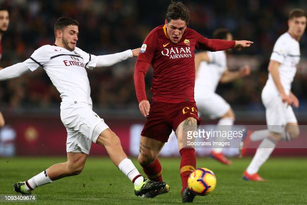 Nicolo Zaniolo of AS Roma Davide Calabria of AC Milan during the Italian Serie A match between AS Roma v AC Milan at the Stadio Olimpico Rome on...
