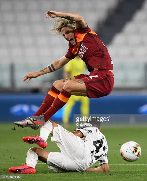 Nicolo Zaniolo of AS Roma fouled by Gianluca Frabotta of Juventus during the Serie A match between Juventus and AS Roma at on August 1, 2020 in...