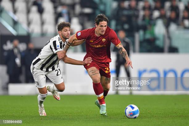 Nicolo Zaniolo of AS Roma is challenged by Manuel Locatelli of Juventus during the Serie A match between Juventus and AS Roma at on October 17, 2021...