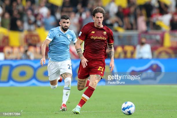 Nicolo Zaniolo of AS Roma runs with the ball during the Serie A match between SS Lazio and AS Roma at Stadio Olimpico on September 26, 2021 in Rome,...