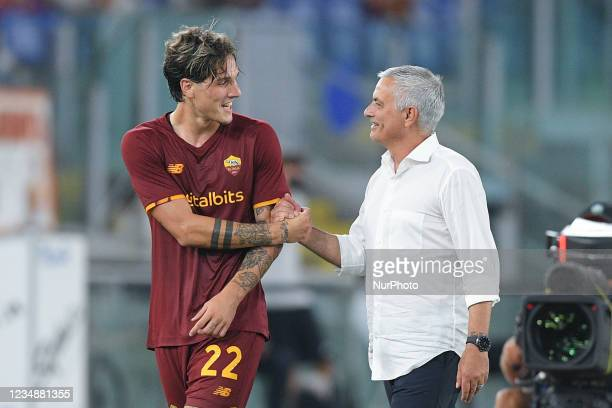 Nicolo Zaniolo of AS Roma shakes hands with Jose Mourinho manager of AS Roma leaving the pitch during the UEFA Conference League Play-Offs Second Leg...