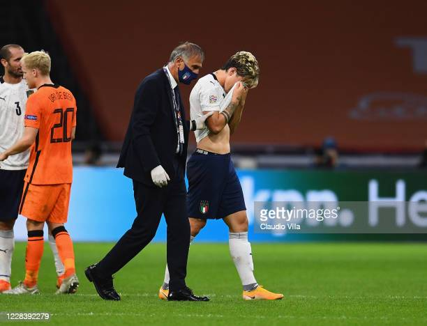 Nicolo Zaniolo of Italy is taken off injured during the UEFA Nations League group stage match between Netherlands and Italy at Johan Cruijff Arena on...