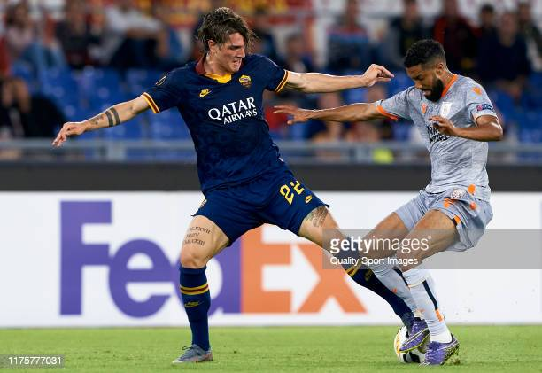 Nicolo Zaniolo of Roma competes for the ball with Gael Clichy of Istanbul Basaksehir during the UEFA Europa League group J match between AS Roma and...