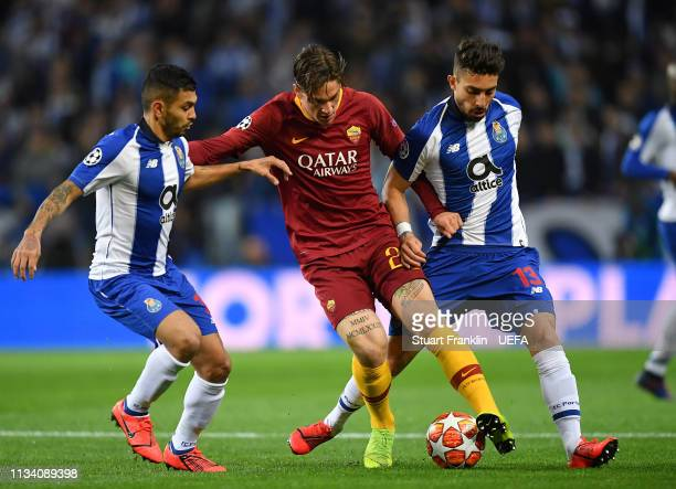 Nicolo Zaniolo of Roma is challenged by Alex Telles and Jesús Corona of Porto during the UEFA Champions League Round of 16 Second Leg match between...