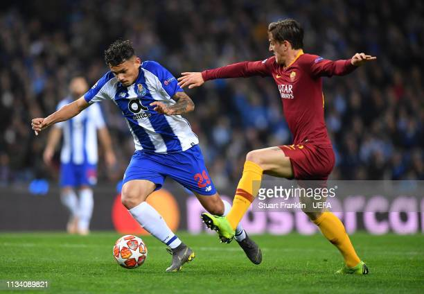 Nicolo Zaniolo of Roma is challenged by Tiquinho Soares of Porto during the UEFA Champions League Round of 16 Second Leg match between FC Porto and...