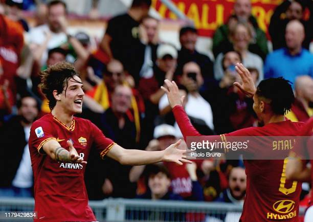 Nicolo' Zaniolo with his teammates of AS Roma celebrates after scoring the opening goal during the Serie A match between AS Roma and SSC Napoli at...