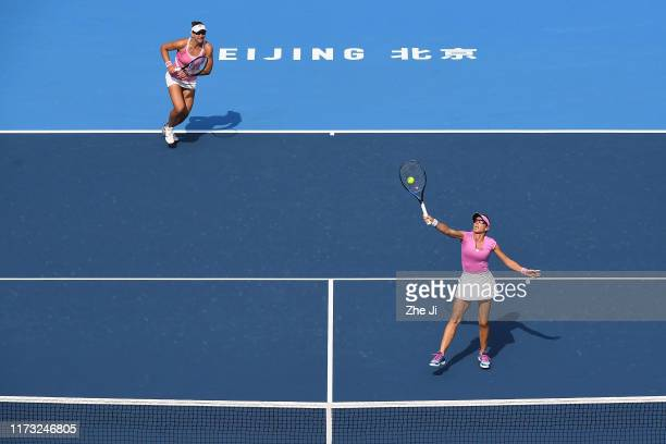 Nicoloe Melichar of the United States and Kveta Peschke of Czech Republic return a shot against their Women's doubles Quarterfinal match of 2019...