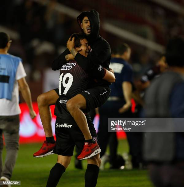 Nicolás Aguirre of Lanus celebrates with teammate Roman Martinez after winning a second leg match between Lanus and River Plate as part of the...