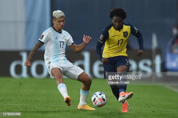 Nicolás Dominguez fights for the ball with Angelo Preciado of Ecuador during a match between Argentina and Ecuador as part of South American...
