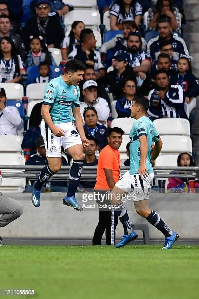 Nicolás Ibáñez of San Luis celebrates with teammate Germán Berterame after scoring his team's second goal during the 9th round match between...