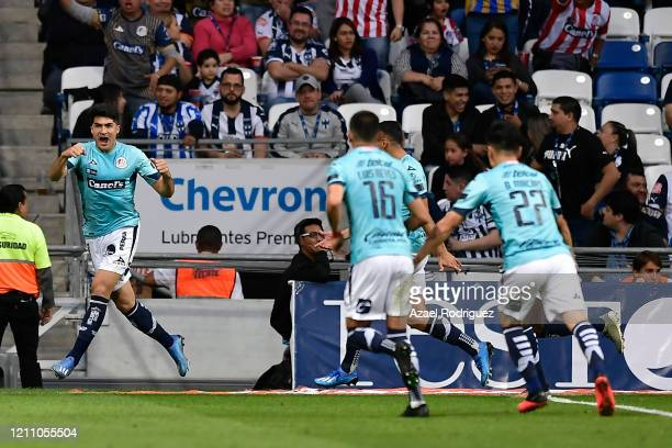Nicolás Ibáñez of San Luis celebrates with teammates after scoring his team's second goal during the 9th round match between Monterrey and Atletico...