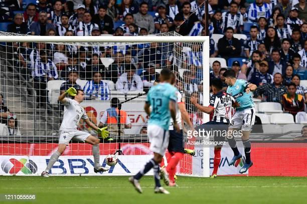 Nicolás Ibáñez of San Luis scores his team's second goal over Marcelo Barovero of Monterrey during the 9th round match between Monterrey and Atletico...