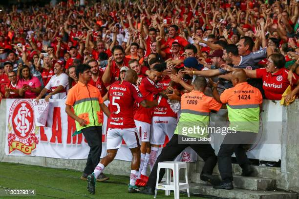 Nicolás Lopez of Internacional celebrates with fans after scoring the first goal of his team during the match between Internacional v Alianza Lima -...