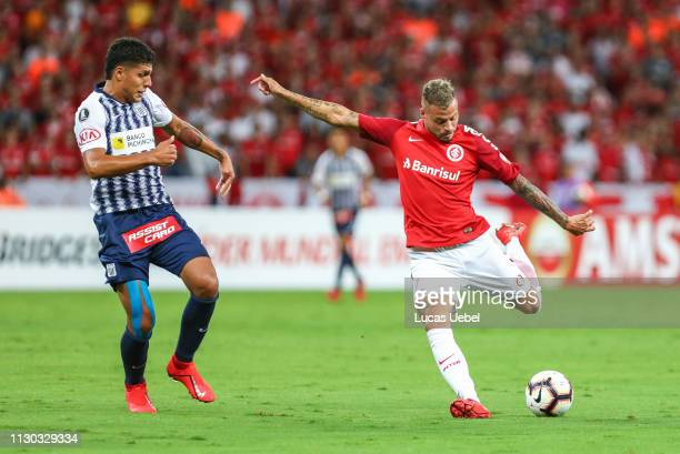 Nicolás Lopez of Internacional kicks the ball against Luis Ramírez of Alianza Lima during the match between Internacional v Alianza Lima Copa...