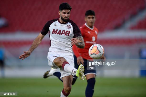 Nicolás Orsini of Lanus kicks the ball to score the third goal of his team during a quarter final second leg match between Independiente and Lanus as...