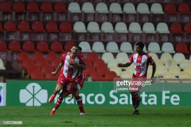 Nicolás Peñailillo of Unión celebrates with teammates after scoring his team's first goal during a match between Union and Boca Juniors as part of...
