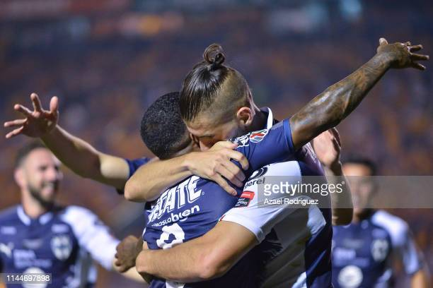 Nicolás Sánchez, #4 of Monterrey, celebrates with teammate Dorlan Pabón after scoring his team's first goal during the final first leg match between...