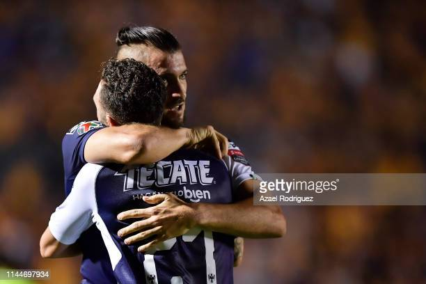Nicolás Sánchez, #4 of Monterrey, celebrates with teammate Miguel Layún, #21 after scoring his team's first goal during the final first leg match...