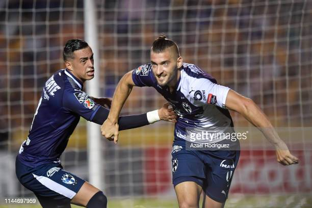 Nicolás Sánchez, #4 of Monterrey, celebrates with teammate Rogelio Funes Mori after scoring his team's first goal during the final first leg match...