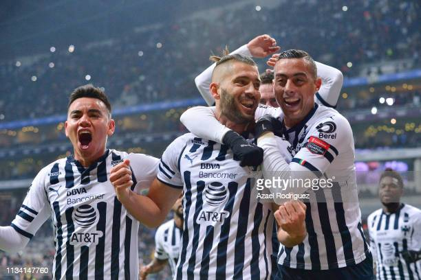 Nicolás Sánchez of Monterrey celebrates with teammates Rogelio Funes Mori and Carlos Rodríguez after scoring his team's first goal via penalty during...
