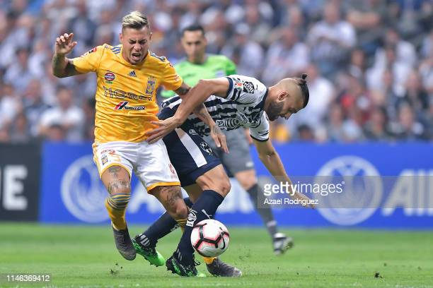 Nicolás Sánchez of Monterrey fights for the ball with Eduardo Vargas of Tigres during the final second leg match between Monterrey and Tigres UANL as...