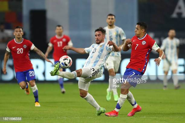 Nicolás Tagliafico of Argentina fights for the ball with Alexis Sanchez of Chile during a match between Argentina and Chile as part of South American...