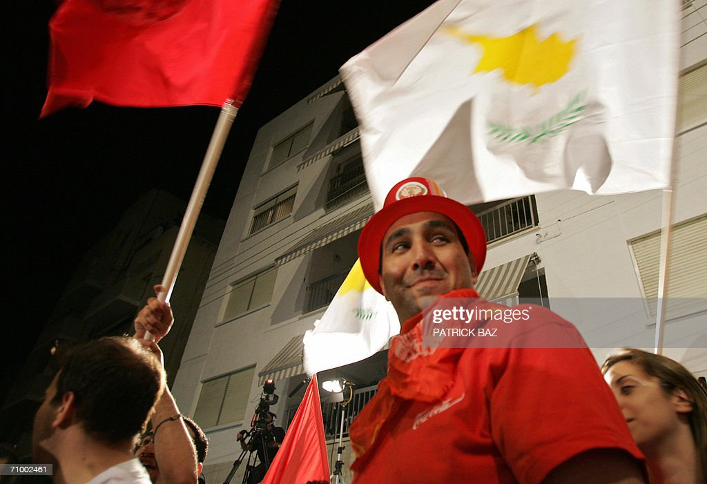 Cypriot Communist Party supporters wave : News Photo