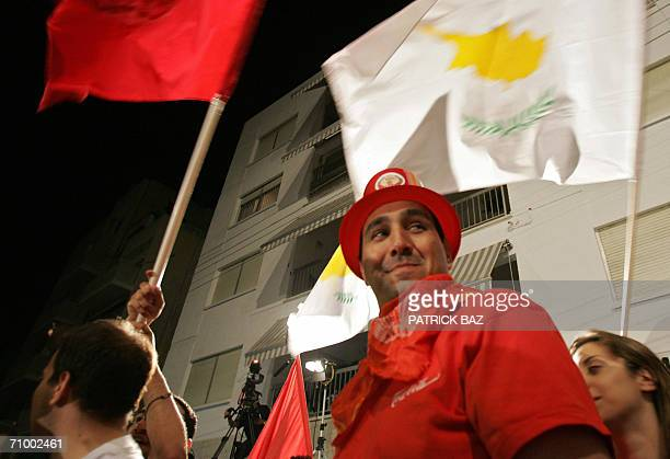 Cypriot Communist Party supporters wave party and national flags during celebrations following today's elections in the capital Nicosia 21 May 2006...