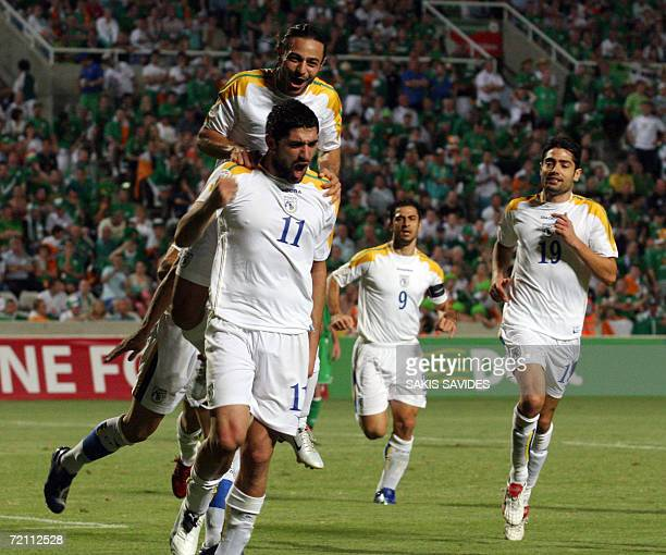 Cypriot players celebrate after their teammate Michael Constantinou scores a goal against Ireland during their Euro 2008 qualifying football match at...