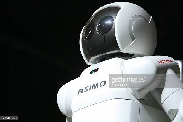 Honda's humanoid robot ASIMO stands on stage at an event at the University of Cyprus Nicosia 05 May 2007 The ASIMO robot was designed to have...