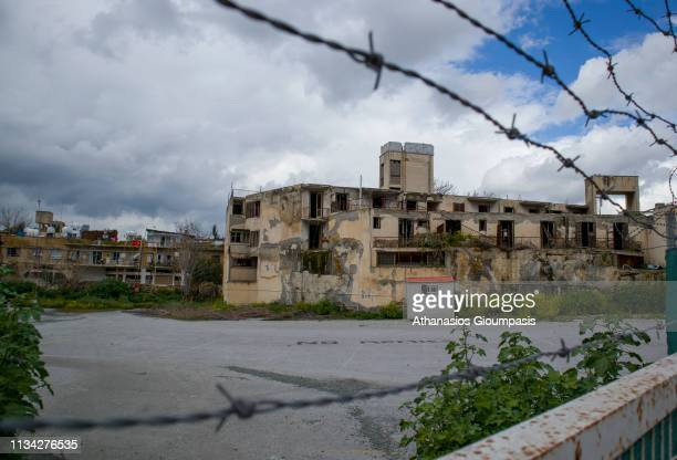 Nicosia ghost town on March 03, 2019 in Nicosia, Cyprus. After 1974 Turkey invaded Cyprus derelict homes, hotels and airports in Nicosia is the...