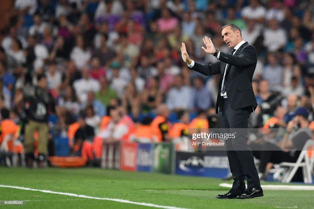 Nicosia's coach from Greece Giorgos Donis gestures during the UEFA Champions League football match Real Madrid CF vs APOEL FC at the Santiago Bernabeu stadium in Madrid on September 13, 2017. /