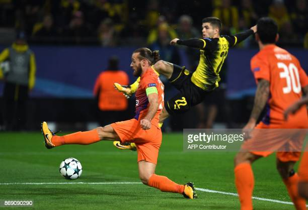 Nicosia's Cypriot midfielder Nektarios Alexandrou and Dortmund's US midfielder Christian Pulisic vie for the ball during the UEFA Champions League...