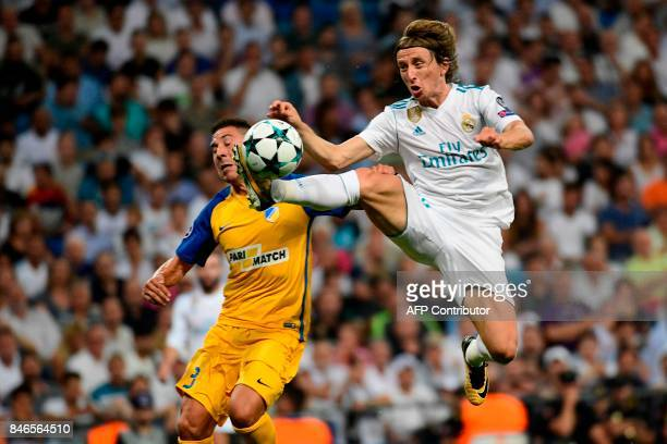 Nicosia's defender from Spain Roberto Lago vies with Real Madrid's midfielder from Croatia Luka Modric during the UEFA Champions League football...