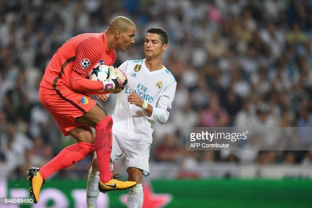 Nicosia's goalkeeper from the Netherlands Boy Waterman vies with Real Madrid's forward from Portugal Cristiano Ronaldo during the UEFA Champions...