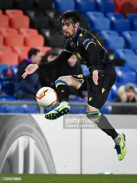 Nicosia's Greek defender Praxitelis Vouros controls the ball during the UEFA Europa League Last 32 Second Leg football match between FC Basel and...