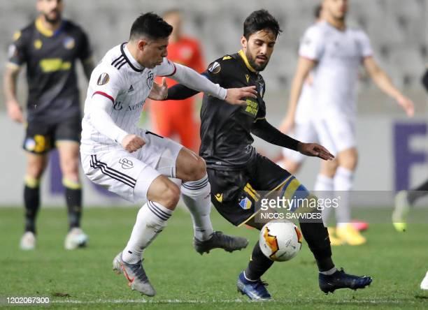 Nicosia's Jordanian midfielder Musa Suliman Al-Taamari vies for the ball against FC Basel's Paraguayan defender Blas Riveros during the Europa League...