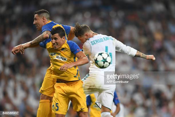 Nicosia's midfielder from Spain Jesus Rueda vies with Real Madrid's defender from Spain Sergio Ramos during the UEFA Champions League football match...