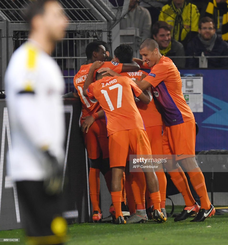 Nicosia's players celebrate after scoring during the UEFA Champions League Group H football match BVB Borussia Dortmund v Apoel Nicosia on November 1, 2017 in Dortmund, western Germany. /