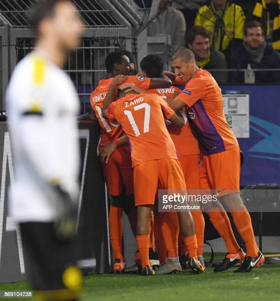 Nicosia's players celebrate after scoring during the UEFA Champions League Group H football match BVB Borussia Dortmund v Apoel Nicosia on November 1...