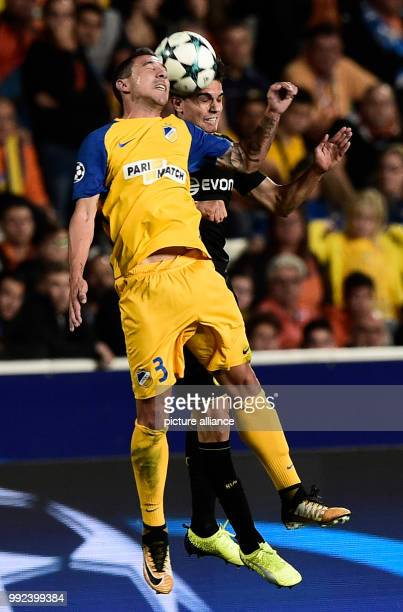 Nicosia's Roberto Lago and Dortmund's Marc Bartra vie for the ball during the Champions League group stages qualification match between APOELNicosia...