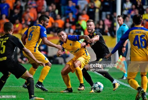 Nicosia's Spanish defender Roberto Lago vies for the ball with Dortmund's Ukrainian forward Andrei Yarmolenko during the UEFA Champions League...