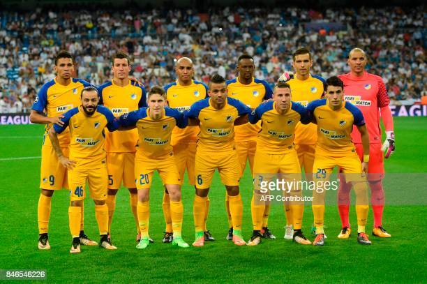 Nicosie's players line up before the UEFA Champions League football match Real Madrid CF vs APOEL FC at the Santiago Bernabeu stadium in Madrid on...